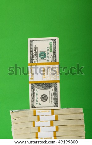 Stack of dollars isolated on the green - stock photo
