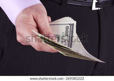 Stack of dollars. The US$. Stack of dollars. Wages, profits, savings. Man counting money. Dollars in man's hands. A man in business clothes with dollars. Success, motivation, financial flows, wealth.  - stock photo