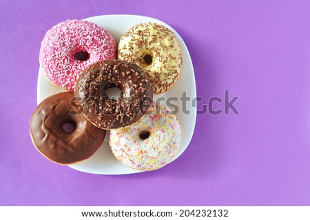 Stack of donuts on a plate - stock photo