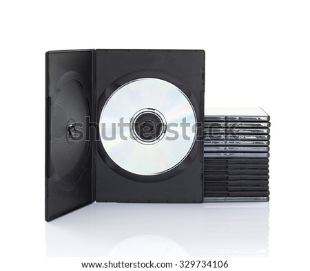 Stack of dvd boxes with disc on white background - stock photo