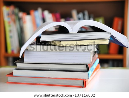 Stack of Education books on table in library, selective focus. - stock photo
