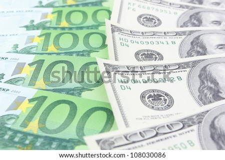 Stack of euro and dollar banknotes - stock photo