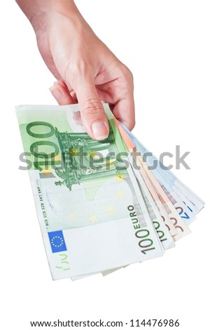 Stack of Euro in hand - stock photo