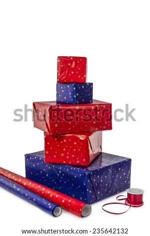 Stack of five presents in different sizes with blue and red wrapping paper and ribbon isolated on white background
