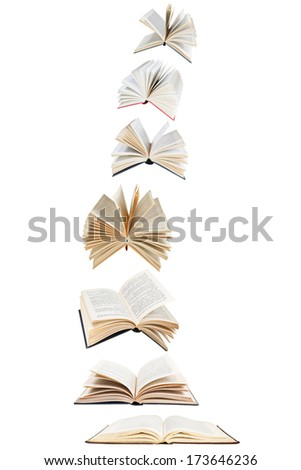 stack of flying books isolated on white background - stock photo