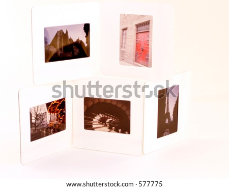 Stack of four 35mm slides showing travel scenes of Europe. - stock photo