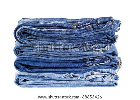 Stack of four various shades blue jeans - isolated - stock photo