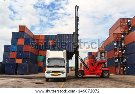 Stack of Freight Containers at the Docks with Truck  - stock photo