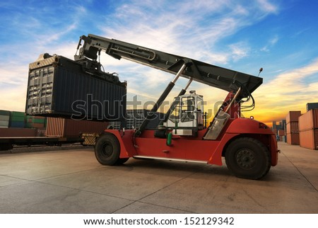 Stack of Freight Containers at the Docks with Truck