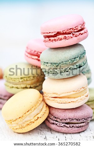 Stack of fresh colorful macarons. Extreme shallow depth of field with selective focus. - stock photo