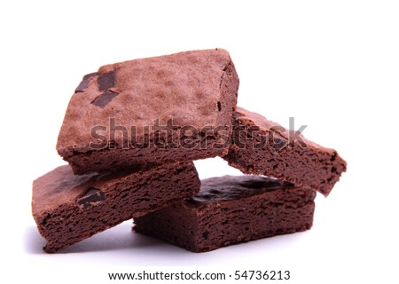 Stack of freshly made chocolate brownies on a white background. - stock photo