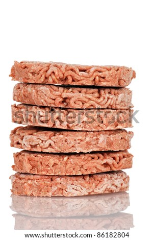 Stack of frozen hamburgers - stock photo