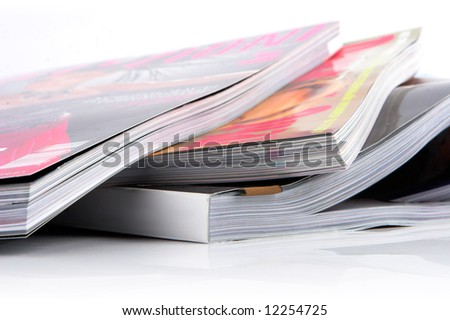 Stack of glossy magazines on a white background. - stock photo