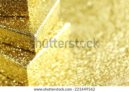 Stack of Gold decorative boxes with holiday gifts on abstract gold background - stock photo