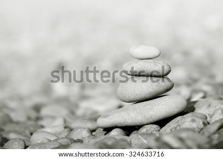 Stack of gray pebble stones close up - stock photo