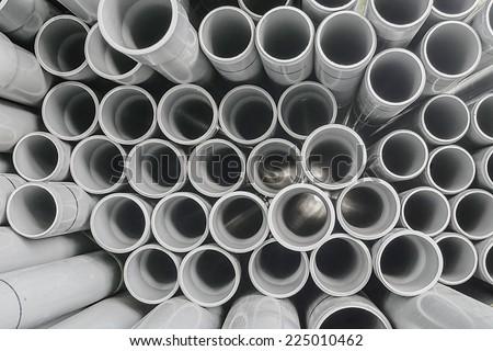 Stack of Gray PVC Pipes Arranged Randomly - stock photo