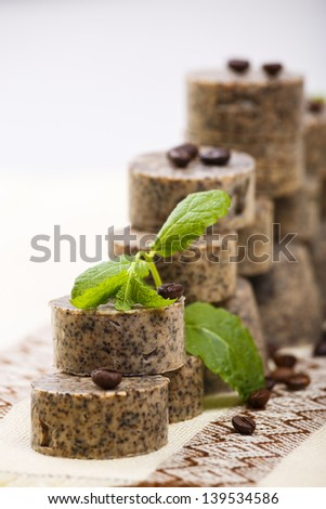 Stack of handmade brown soap bars with scent of coffee and lavender. Selective focus. - stock photo