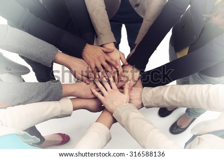 Stack of hands - stock photo