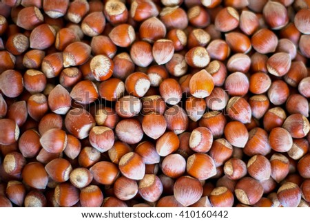 Stack of hazelnuts. Hazelnut background, selective focus - stock photo