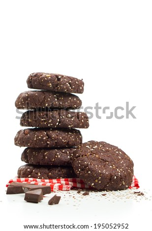 Stack of healthy dark chocolate almond chia seed cookies on white background - stock photo