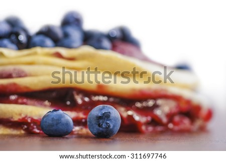 Stack of homemade pancakes with fresh blueberries. Soft focus view. - stock photo
