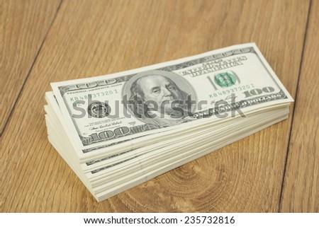 Stack of hundred-dollar bills - stock photo