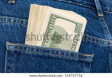 Stack of hundred dollar bills in the back jeans pocket - stock photo