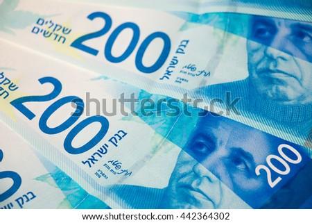 Stack of Israeli money bills of 200 shekel - top view. - stock photo