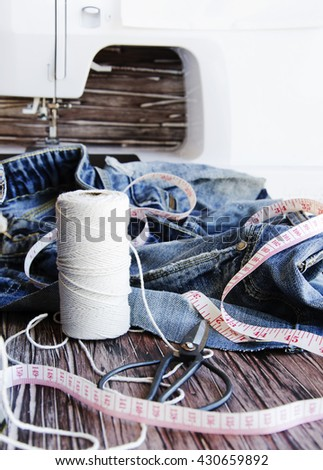 stack of jeans lying on a wooden table