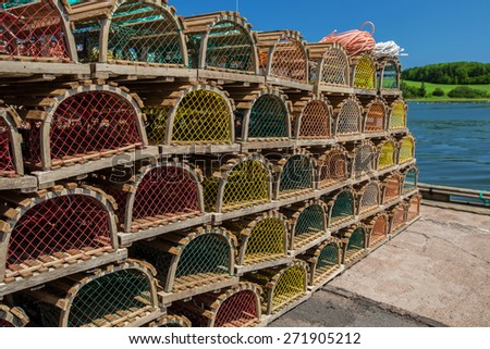 Stack of lobster traps on a wharf in rural Prince Edward Island, Canada. - stock photo