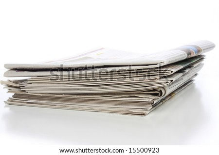 Stack of local, regional, national and international newspapers - stock photo