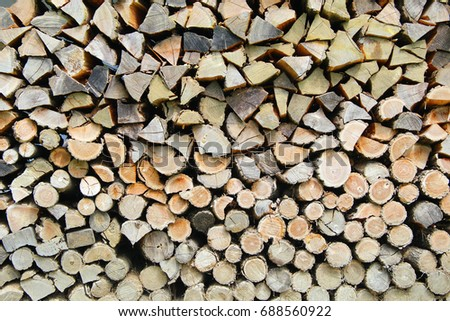 Stack of logs of various shapes and colour tones