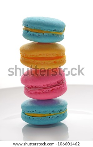 Stack of macarons on the white plate - stock photo