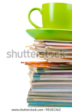 stack of magazines and cup isolated on white