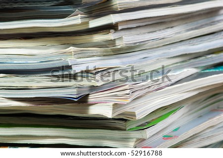 Stack of magazines . Close - up.