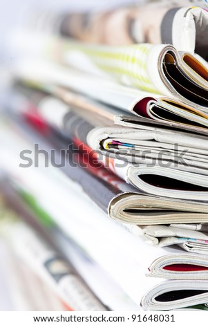 stack of magazines isolated on white - stock photo