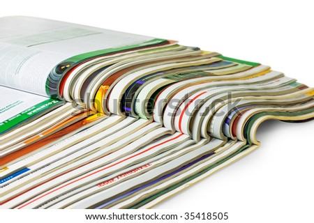 stack of magazines isolated on white background - stock photo