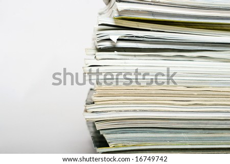 Stack of magazines on neutral background closeup
