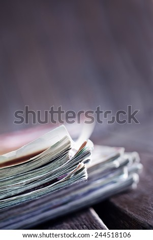 stack of magazines on the wooden table - stock photo