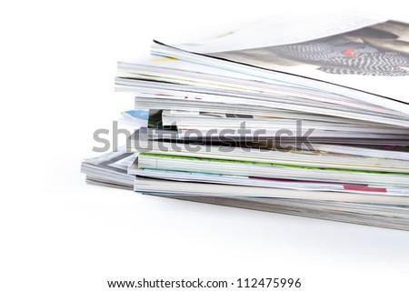 stack of magazines on white background - stock photo
