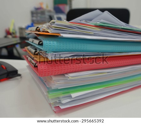 Stack of many color document folder on desk at office.                                - stock photo