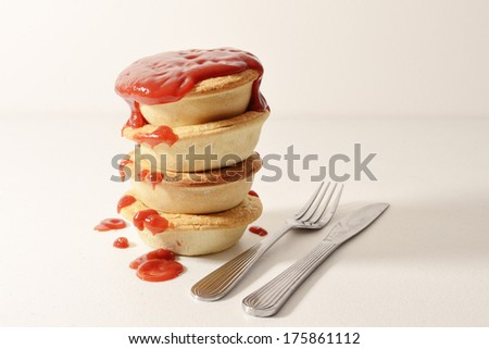 Stack of meat pies - stock photo