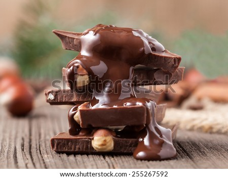 Stack of melted chocolate with nuts  - stock photo