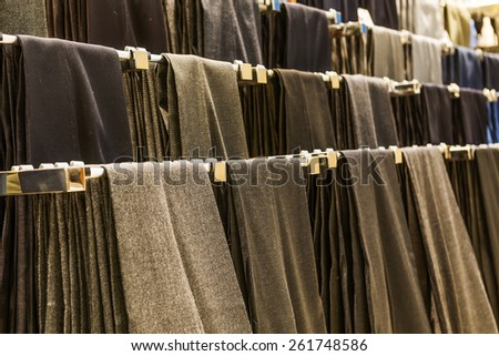 Stack of men's trousers - stock photo