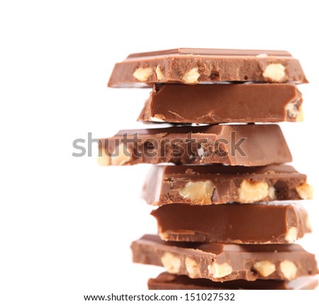 Stack of milk chocolate bar with nuts - stock photo