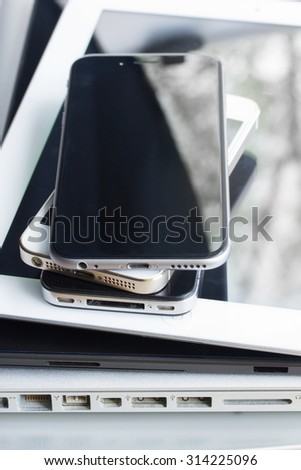stack of modern electronical devices close up - technology concept - stock photo