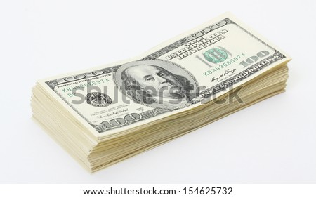Stack of money american hundred dollar bills on white background - stock photo