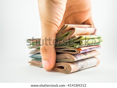 Stack of money in hand isolated on white background - stock photo