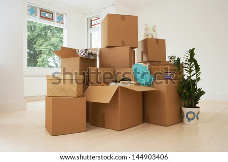 Stack of moving boxes in new house