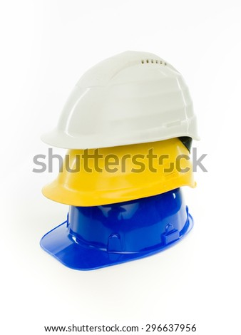 stack of multi colored hardhats isolated on white background - stock photo